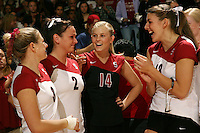 18 November 2005: Katie Goldhahn and Courtney Schultz and Lizzy Suiter and Kirsten Hornbeak during Stanford's 3-2 win over California in the Big Spike at Maples Pavilion in Stanford, CA.