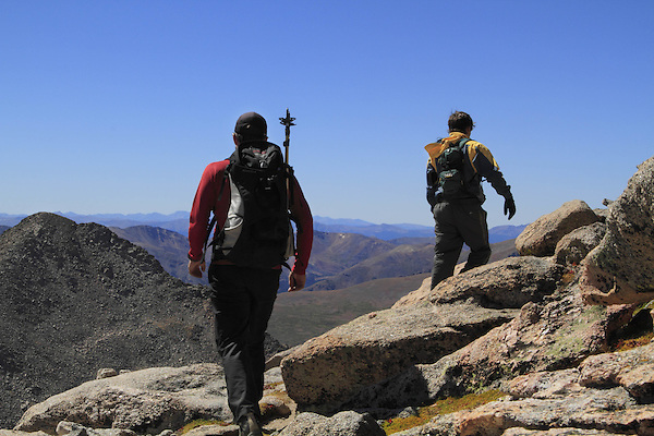 Two men hiking towards the summit of Mount Evans (14250 feet) with Mount Bierstadt on the left, in the Rocky Mountains west of Denver, Colorado. Hiking photo tours to Mt Evans.