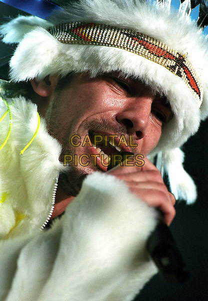 JAMIROQUAI.In Concert at Wembly Arena .Ref: 11514.Jay Kay, singing, feathers, headshot, portrait.www.capitalpictures.com.sales@capitalpictures.com.© Capital Pictures