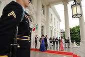 United States President Barack Obama and First Lady Michelle Obama arrive to welcome Mexican President Felipe Calderon and Mexican First Lady Margarita Zavala on the North Portico of the White House for a State Dinner in Washington on Wednesday, May 19, 2010.   .Credit: Roger L. Wollenberg - Pool via CNP