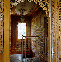 Every inch of the landing walls and ceiling are covered in fretwork and the window has an ornate filigree architrave