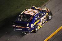 Jul. 5, 2008; Daytona Beach, FL, USA; NASCAR Sprint Cup Series driver Michael Waltrip after crashing during the Coke Zero 400 at Daytona International Speedway. Mandatory Credit: Mark J. Rebilas-