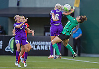 Portland, Oregon - Sunday April 17, 2016: Orlando Pride midfielder Kaylyn Kyle (6) and Portland Thorns FC goalkeeper Michelle Betos (18). The Portland Thorns play the Orlando Pride during a regular season NWSL match at Providence Park.