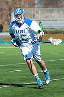 Cam Brazil,'16, follows game action as the Seahawks battle Endicott in Men's Lacrosse at Gaudet Field in Middletown.