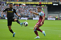 Aaron Cresswell and Riyad Mahrez of Manchester City during West Ham United vs Manchester City, Premier League Football at The London Stadium on 10th August 2019