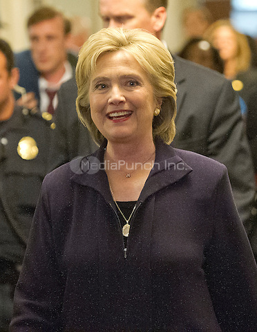 Former United States Secretary of State Hillary Rodham Clinton, a candidate for the 2016 Democratic Party nomination for President of the United States, smiles as she departs after giving testimony before the US House Select Committee on Benghazi on Capitol Hill in Washington, DC on Thursday, October 22, 2015.<br /> Credit: Ron Sachs / CNP/MediaPunch<br /> (RESTRICTION: NO New York or New Jersey Newspapers or newspapers within a 75 mile radius of New York City)