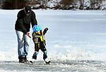 David Thomas of Enfield, has to catch his son David, 3, who was having a little touch of the beginners wobbles while skating on the pond behind St Martha's Church on Brainard Road, Saturday, January 20, 2018, in Enfield. (Jim Michaud / Journal Inquirer)