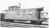 Side view of long caboose 04343, flying herald, round roof.<br /> D&amp;RGW  Alamosa, CO  Taken by Gibson, William A. Sr. - 8/29/1956
