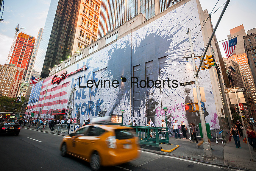 """A mural by the artist  Mr. Brainwash is seen on the side of the Century 21 department store in across from the World Trade Center site in New York on Thursday, September 11, 2014. The mural covers the entire side of the store and will remain in view for three weeks. Mr. Brainwash is the """"nom de art"""" of 48 year old artist Thierry Guetta featured in the Banksy film """"Exit Through the Gift Shop"""". (© Richard B. Levine)"""