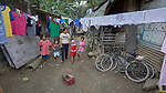 Christian Love Daroy-Gagno, the program director of the Kapatiran-Kaunlaran Foundation (KKFI), walks with children in Pulilan, a village in Bulacan, Philippines, where KKFI has an educational program.<br /> <br /> KKFI is supported by United Methodist Women.