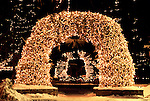 Holiday lights decorate the antler arches on the Town Square of Jackson, Wyoming.