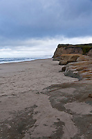 Footprints in the sand - the ghosts of those who tromped and played in the sand below the bluffs at Pomponio State Beach south of Half Moon Bay, California.