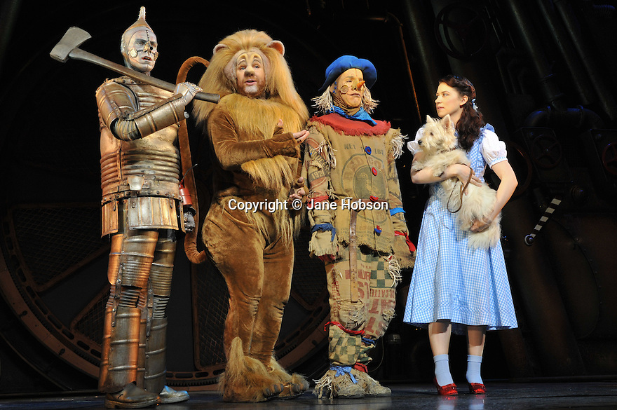 "London, Uk. 25/02/2011. Tin Man (Edward Baker-Duly), Lion (David Ganly), Dorothy (Danielle Hope) and Toto (Dazzle). ""The Wizard of Oz"" opens at The London Palladium.  Written by Andrew-Lloyd Webber and Tim Rice, in their first pairing for 30 years on a new production, it stars Danielle Hope as Dorothy, Michael Crawford as The eponymous Wizard, Edward Baker-Duly as Tin Man, David Ganly as Lion and Paul Keating as Scarecrow. Picture credit should read: Jane Hobson"