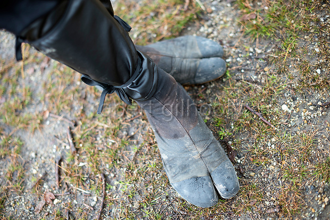 "Ninja Chris  ""Sora"" O'Neil shows off his tabi footwear in the grounds of Nagoya Castle, Aichi Prefecture Japan on Feb. 23, 2017. O'Neil is one of the eight ninja corps who roam the avenues of the castle and Nagoya Airport, jumping from behind trees and bushes to surprise visitors. ROB GILHOOLY PHOTO"