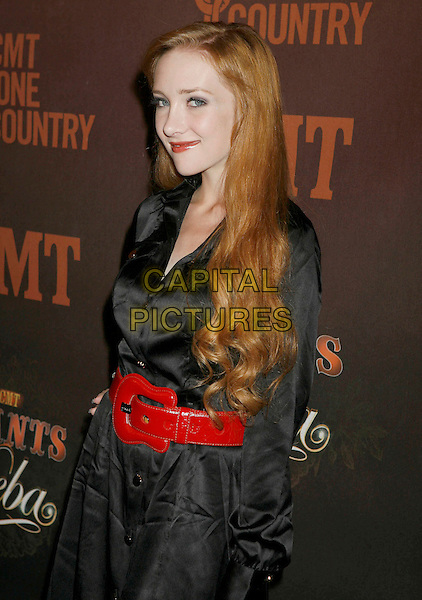 "SCARLETT POMERS.Arrivals at ""CMT Giants"" Honoring Reba McEntire held at the Kodak Theatre, Hollywood, LA, California, USA,.26 October 2006..half length red belt black.Ref: ADM/RE.www.capitalpictures.com.sales@capitalpictures.com.©Russ Elliot/AdMedia/Capital Pictures."