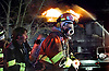 Barnegat firefighter Mark Longo dons a new air pack to fight a fire that destroyed a home in Barnegat Twp. Peter Ackerman/Asbury Park Press