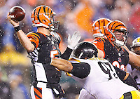 AJ McCarron #5 of the Cincinnati Bengals is hit by Cameron Heyward #97 of the Pittsburgh Steelers while throwing during the Wild Card playoff game at Paul Brown Stadium on January 9, 2016 in Cincinnati, Ohio. (Photo by Jared Wickerham/DKPittsburghSports)