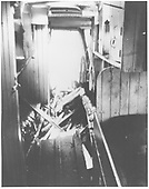 Interior of wrecked RGS caboose caused by runaway flat car from Rico on July 26, 1948.<br /> RGS    7/1948