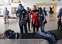 Wednesday 07 August 2013<br /> Pictured L-R: Michel Vorm, Lee Trundle and Nathan Dyer wait for their luggage after landing at Malmo Airport<br /> Re: Swansea City FC travelling to Sweden for their Europa League 3rd Qualifying Round, Second Leg game against Malmo.