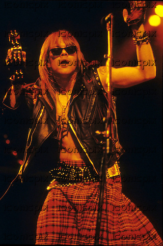 GUNS N' ROSES - Axl Rose - performing live on the Use Your Illusion World Tour - 1991-1994.  Photo credit: George Chin/IconicPix