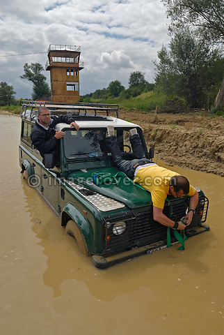 Fixing a recovery strap for recovery of a Land Rover Defender stuck in a puddle while off roading in Bining, France. --- No releases available. Automotive trademarks are the property of the trademark holder, authorization may be needed for some uses.