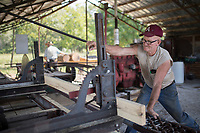 NWA Democrat-Gazette/CHARLIE KAIJO Harold Bowen of Wesley pulls lumber into a saw at the Tired Iron of the Ozarks in Gentry, AR on Friday, September 7, 2017. The show features old time Tractors and Engines and exhibitions of old-time saw milling and blacksmith work.