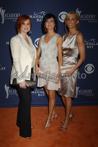 May 26, 2004; Las Vegas, NV, USA; Musicians KELSI OSBORN, KASSIDY OSBORN and KRISTYN OSBORN of 'SHeDAISY' during the 39th Annual Academy of Country Music Awards held at Mandalay Bay Resort and Casino. Mandatory Credit: Photo by Laura Farr/AdMedia. (©) Copyright 2004 by Laura Farr