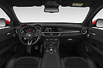 Stock photo of straight dashboard view of 2019 Alfaromeo Stelvio-Quadrifoglio - 5 Door SUV Dashboard