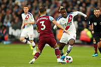 Aaron Cresswell of West Ham United and Wilfried Zaha of Crystal Palace during West Ham United vs Crystal Palace, Premier League Football at The London Stadium on 5th October 2019