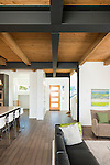 Wood ceiling and exposed metal beams in the great room of contemporary home. This image is available through an alternate architectural stock image agency, Collinstock located here: http://www.collinstock.com