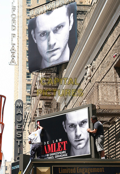 "ATMOSPHERE.Workmen installing signage for Jude Law's appearance as ""Hamlet"" on Broadway this fall in New York City, NY, USA, August 17th 2009..poster face theatre theater sign ad advertising .CAP/LNC/TOM.©LNC/Capital Pictures."