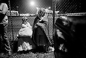 Wise, Virginia<br /> USA<br /> July 24, 2009<br /> <br /> Haley Giterson, left and her sister wait at 5AM with many people sleep overnight in their cars in hopes of being the first in line and then waiting in line at 5.30AM to enter a Remote Area Medical (RAM) health clinic at the Wise County Fairgrounds. The free clinic, which lasts 2-1/2 days, is the largest of its kind in the nation, providing medical, dental and vision services from more than 1,400 medical volunteers will treat nearly 4,000 patients. For many residents of this Appalachian area the RAM clinic serves as the only medical care they may receive each year.