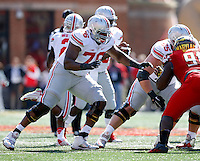 Ohio State Buckeyes offensive lineman Darryl Baldwin (76) blocks Maryland Terrapins defensive lineman Keith Bowers (91) during the Buckeyes' 52-24 win over the Maryland Terrapins in the NCAA football game at Byrd Stadium in College Park, Maryland on Oct. 4, 2014. (Adam Cairns / The Columbus Dispatch)