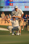 Ian Poulter lines up his putt with his caddy on the 18th green during the Final Day of the Dubai World Championship, Earth Course, Jumeirah Golf Estates, Dubai, 28th November 2010..(Picture Eoin Clarke/www.golffile.ie)