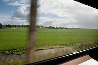 Netherlands,   <br /> <br /> View from the train from Amsterdam to Hoorn on the rural landscape of North Holland.<br /> <br /> Uitzicht uit de trein naar Hoorn. Noord Hollands en in de buurt van Hoorn het westfriese landschap.<br /> <br /> Photo Kees Metselaar/ Hollandse Hoogte