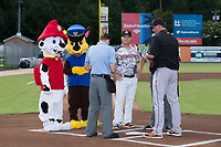 Kannapolis Intimidators manager Justin Jirschele (9) is joined at home plate by the Paw Patrol as he exchanges lineups with Delmarva Shorebirds manager Ryan Minor and home plate umpire Sam Burch at Kannapolis Intimidators Stadium on June 30, 2017 in Kannapolis, North Carolina.  The Shorebirds defeated the Intimidators 6-4.  (Brian Westerholt/Four Seam Images)