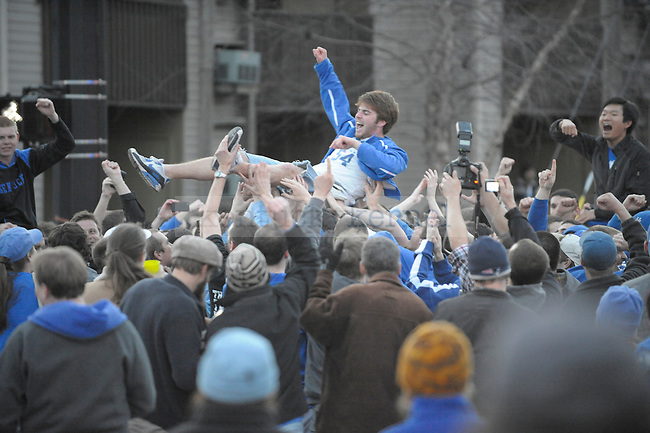 UK fans celebrate the UK Men's basketball victory over the University of North Carolina at the corner of Woodland and Euclid in Lexington, Ky., on 3/27/11. . Photo by Mike Weaver | Staff