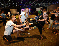 NWA Democrat-Gazette/ANDY SHUPE<br /> McKinlee Henderson, 9, of Fayetteville (right) kicks a board in two Thursday, June 6, 2019, as Nathan Murdock (left), owner of Inferno Fitness and Martial Arts and student Katie Games give instruction during First Thursday inside the Fayetteville Town Center. The monthly arts and music celebration was moved inside from its usual place on the city's downtown square because of rain.