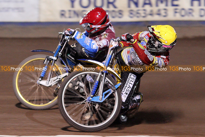 Heat 10: Simon Stead (yellow) and Krzysztof Kasprzak (red) - Lakeside Hammers vs Swindon Robins, Elite League Speedway at the Arena Essex Raceway, Purfleet - 23/04/10 - MANDATORY CREDIT: Rob Newell/TGSPHOTO - Self billing applies where appropriate - 0845 094 6026 - contact@tgsphoto.co.uk - NO UNPAID USE.