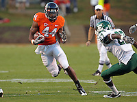 Oct 23, 2010; Charlottesville, VA, USA;  Virginia Cavaliers running back Raynard Horne (44) runs the ball during the game against the Eastern Michigan Eagles at Scott Stadium.  Virginia won 48-21. Mandatory Credit: Andrew Shurtleff