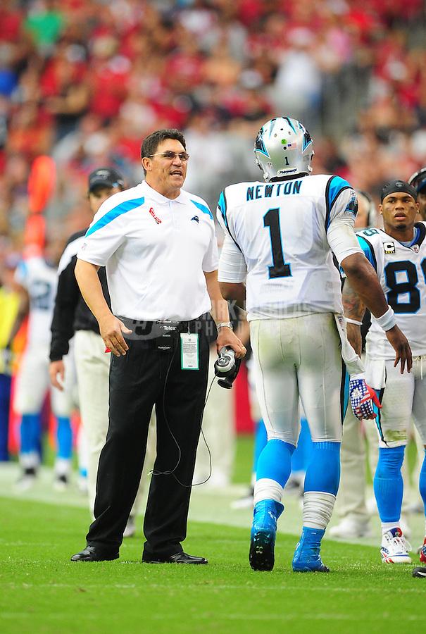 Sept. 11, 2011; Glendale, AZ, USA; Carolina Panthers head coach Ron Rivera (left) talks to quarterback (1) Cam Newton against the Arizona Cardinals at University of Phoenix Stadium. The Cardinals defeated the Panthers 28-21. Mandatory Credit: Mark J. Rebilas-