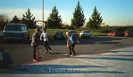 Mike Avery, Jason Livermore, Joey Vela skateboarding at California High School.; San Ramon, CA<br />