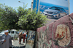 A street scene in Ramallah, West Bank. The late Palestinian leader Yasser Arafat is on the poster in center.