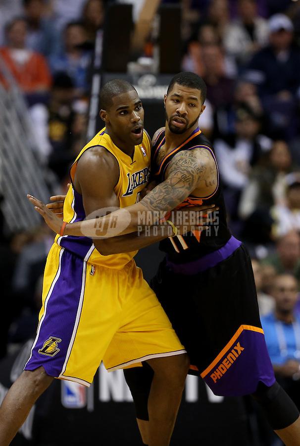 Jan. 30, 2013; Phoenix, AZ, USA: Los Angeles Lakers forward Antawn Jamison (left) against Phoenix Suns forward Markieff Morris at the US Airways Center. Mandatory Credit: Mark J. Rebilas-