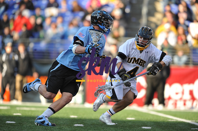 Johns Hopkins easily defeated the UMBC Retrievers 16 - 5 in the third game of Konica Minolta's Face Off Classic day of lacrosse at M&T Bank Stadium in Baltimore on Saturday.