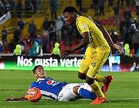 BOGOTA - COLOMBIA - 12 - 02 - 2017: Cristian Arango (Izq.) jugador de Millonarios disputa el balón con Nicolas Palacios (Der.) jugador de Atletico Bucaramanga, durante partido de la fecha 3 entre Millonarios y Atletico Bucaramanga, de la Liga Aguila I-2017, jugado en el estadio Nemesio Camacho El Campin de la ciudad de Bogota.  / Cristian Arango (L) player of Millonarios vies for the ball with con Nicolas Palacios (R) player of Atletico Bucaramanga, during a match between Millonarios and Atletico Bucaramanga, for the date 3 of the Liga Aguila I-2017 played at the Nemesio Camacho El Campin Stadium in Bogota city, Photo: VizzorImage / Luis Ramirez / Staff.