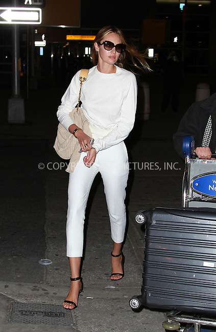 WWW.ACEPIXS.COM....March 13 2013, New York City....Model Candice Swanepoel arrives at JFK airport on March 13 2013 in New York City....By Line: John Peters/ACE Pictures......ACE Pictures, Inc...tel: 646 769 0430..Email: info@acepixs.com..www.acepixs.com