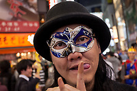 A Japanese man wearing a mask enjoys Halloween celebrations in Shibuya. Saturday October 28th 2017