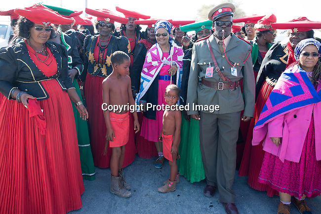 OTJIWARONGO, NAMBIA- AUGUST 12: Herero people dressed in traditional clothing, and men in military uniforms, stop during a march when commemorating fallen chiefs killed in battles with Germans. The area was the venue for decisive battles of the Herero uprisings in 1904.  The Herero accuse the German Empire of Genocide of its people from 1904-07. They are currently trying to make the German government compensate the descendants of the people killed. (Photo by Per-Anders Pettersson)