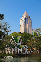 Contrasting traditional style architecture and modern new building. Bangkok, Thailand